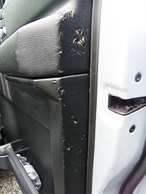 Land Rover Discovery damaged door trim panel